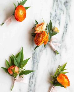 Groomsmen wore bright orange ranunculus boutonnieres by Wild Heart Floral & Event Styling, tied with light pink ribbon.
