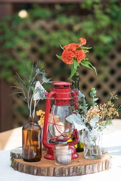 Hurricane lantern + mason jar on wood slice perfect for eclectic wedding & woodland wedding - Hurricane lantern, hurricane lanterns, cranberry wedding, woodland wedding Lantern Centerpiece Wedding, Fall Wedding Centerpieces, Wedding Lanterns, Table Centerpieces, Hurricane Centerpiece, Quinceanera Centerpieces, Centerpiece Ideas, Hippie Party, Cranberry Wedding