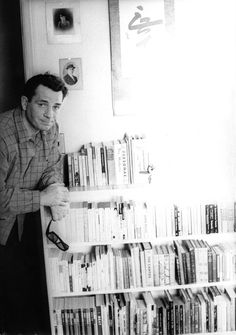 Jack Kerouac and his collection of books. (Source: predatorywaspobserver, via amandaonwriting)