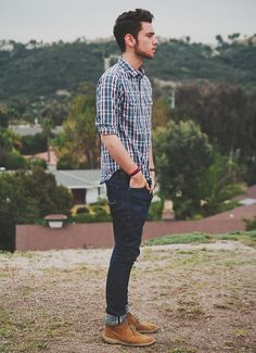 Plaid shirt. Jeans. Shoes.
