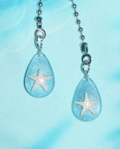 Set of Two - Starfish - Ceiling Fan Pull Chains These ceiling fan pull makes a great gift for yourself or for the special person in your life. This set comes with two starfish fan pulls. Each fan pull chain measures about 1 - 1 1/2 long. They are made of plastic. Each pull chain