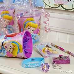 Disney Princess Birthday Party Ideas - Party City. I like the idea of using a cup as the goodie bag.