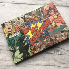 Kapow! Trendy Items to Complete Your Superhero Wedding | Have guests write their name in a book that you and your honey will cherish forever. This handmade guestbook is made with vintage comic books that have been hand cut to create a one-of-a-kind look. ($36.03; FunFonts)