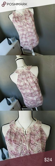 Abstract Print Halter Neckline Blouse *NWOT, Never Worn* Comfortable, breezy, and sexy blouse is sure to have heads turning. Makes a great addition to any casual or work wardrobe; even pairs well with jeans and heels for a night out. Features gathered ruffle neckline, 3/4 button downfront, and a beautiful abstract print in shades of pink and purple against a white background. Approx. measurements: 25 length, 20 inch bust, 9 inch front V-neck depth, 6 inch front V-neck depth. 100% Cotton…