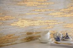 Sick of your kitchen's color? Try a bold tile, like this metallic from New Ravenna, to give new life. If retiling is too complicated, the Home Depot sells a line of convincing trompe l'oeil peel-and-stick tile, which is essentially foolproof to install (and perfect for rental spaces).