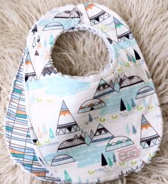 Such a cute tribal bib set for all the little baby boys out there. This super trendy baby boy bib set would make a great complimentary gift to any tribal themed baby boy nursery. This indian summer bi