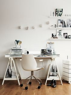 White workspace. Love that shelving.