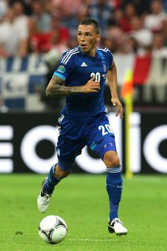 Jose Holebas Photos - Jose Holebas of Greece on the ball during the UEFA EURO 2012 group A match between Poland and Greece at National Stadium on June 2012 in Warsaw, Poland. - Poland v Greece - Group A: UEFA EURO 2012 Euro 2012, National Stadium, Beautiful Islands, Premier League, Poland, Basketball Court, Train, Running, Sports