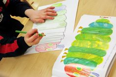 Preschool literature art project. Eric Carle's The Very Hungry Caterpillar. Students used the light table to trace illustrations from the book and then colored their drawing with colored pencils. From a Reggio Emilia inspired preschool.