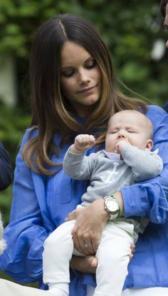 Prince Alexander, just three months old, opens his eyes while being cradled by his mother Princess Sofia