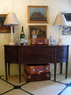 A pretty sideboard.  Don't you just love the vintage suitcases?