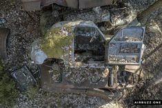 Old Austin a30 flipped on the side with the door open.  The remote Swedish scrapyard where old cars rust in peace! Photographed with a drone. https://airbuzz.one/drone-pictures-of-bastnas-car-cemetery/ #dronephoto #droneblogg #djiblogg #djimavicpro #dji #carcemetery #sweden #carwrecks #oldcars #rustycars #cars #sweden #bilskroten #båstnäs #dronephotography