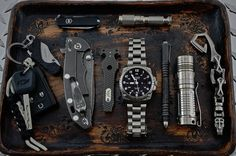 """everydaycarry: """"submitted by Jim Robb • SWISS ARMY BRANDS Black Classic Swiss Army Knife 7 Functions Contains Small Blade • Maratac AAA Flashlight Rev 3 • Kershaw 1025X Cinder Knife, Black • Rick Hinderer XM-18 • Hinderer Tac-Tool • Citizen Eco-Drive..."""