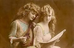 The Musicians  This is an old French postcard from my personal collection depicting one young lady playing her ukelele while the other is holding the sheet music. #women #ukelele #music