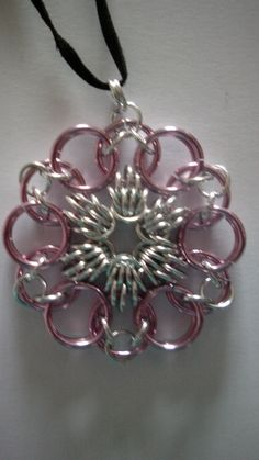 Chainmaille pendant in scherzo weave using ice pink and silver coloured aluminium jump rings