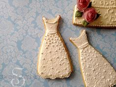 With my wedding just under 6 months away, I have so many cookie ideas swirling around in my head! These wedding dress cookies were made with theGown Cookie Cutter from Karen's Cookies.Click here to see how I made those wafer paper rosesthat you