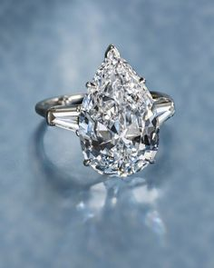 A diamond solitaire ring, Harry Winston. Photo courtesy Bonhams. Ideal wedding ring! Not too much clutter. And doesn't actually have to be that big.