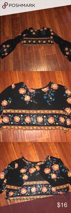 Floral Print bell sleeve crop top NWOT Says size large but can fit a small-medium- large, in my opinion With the back being how it is. I fell in love with this but cannot find anywhere to wear it plus I'm moving and have a lot to sell!!! All offers welcomed and all bundles encouraged Tops Crop Tops