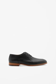 These lace-up shoes are a classic, understated style that are made from smooth panels of polished leather with topstitch detailing around the edges. Lined in leather, they have lightly cushioned insoles and a wood effect heels with a rubber insert. Cos Shoes, Men's Shoes, Dress Shoes, Modern Wardrobe, Mens Essentials, Staple Pieces, Lace Up Shoes, Leather Shoes, Oxford Shoes