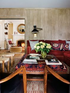 California Eclectic Gets a Traditional Twist// wood panel walls, kilim ottoman, modern sconce