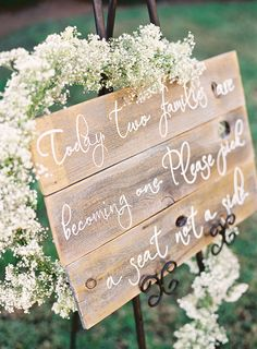 It would be pretty to do a sign like this at our reception. I've seen signs with greens but I didn't even think about flowers. The baby's breath looks so soft and pretty!