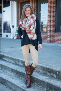 These khaki jeggings have the look of a great pair of skinnies with the comfort provided by thick leggings! The color makes these easy to pair with any boots, tunic or cardi!  Material has a fair amount of stretch.  Miranda is wearing the size 25.