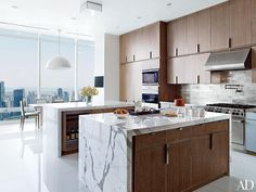 Cerused-oak cabinetry lines a Rockwell Group–designed Manhattan penthouse's kitchen. The wall ovens, range, and hood are all by Wolf, and the backsplash is of nickel tile.