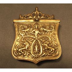 18th century Eastern European brass cartridge box in the form of a shield. The front and sides are cast and chased, the front plate is decorated with a pair of standing lions surmounted by a figure of a woman amidst scrollwork and flanged by two eagles perched on branches. A hinged lid surmounted with elaborated figures of two winged dragons. The rear is fitted with a belt loop for suspension.