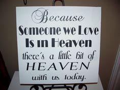 Memory sign -Because Someone we Love is in Heaven - there's a little bit of HEAVEN with us today - Wedding Sign. $24.95, via Etsy.