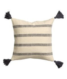Cushion cover in woven cotton fabric with decorative tassels at corners. Concealed zip. Size 16 x 16 in. | H&M US