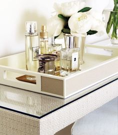 bathroom tray, with perfume and flowers
