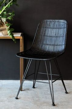 We are seriously excited about this Black Rattan Dining Chair. As part of our collection, this new chair blends together the natural rattan material with sharp black, creating an interesting contrast. Rattan Bar Stools, Rattan Dining Chairs, Leather Dining Room Chairs, Rattan Furniture, Home Furniture, Furniture Design, Furniture Board, Arm Chairs, Metal Furniture