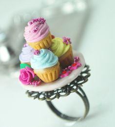 """Marie Antoinette Cupcake Ring in Polymer Clay. Handmade Miniature Polymer Clay Food Jewelry.Everything is mounted on an antique looking, bronze, adjustable ring. Total height of the ring is 1"""" high."""