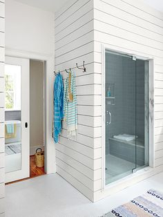 Mirror on the back of the pocket door is a great idea. Photo: Brianne Williams | thisoldhouse.com | from Master Bath as a Grown-Up Getaway