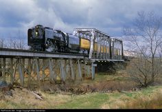 Union Pacific No. 844 leads an eastbound passenger special across the bridge over West Bijou Creek at Byers, Colorado, on a blustery April 28, 2006. This train is traveling over UP's Limon Subdivision, also known as the KP (Kansas Pacific).