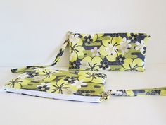 A zipper pouch with Inner zipped change pocket, card slots on the other side, and detachable strap.