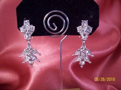 $22 Clip on Vintage Bogoff Rhinestone Dangle Earrings. $22.00, via Etsy.
