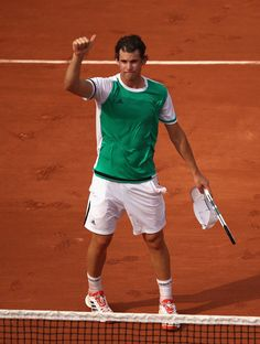 Dominic Thiem Photos Photos - Dominic Thiem of Austria celebrates victory following the mens singles first round match against Bernard Tomic of Australia on day one of the 2017 French Open at Roland Garros on May 28, 2017 in Paris, France. - 2017 French Open - Day One