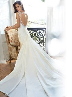 Style Y11562, Mynah, is a beautiful fit and flare wedding dress with cap sleeves designed by Sophia Tolli, click here for more details.