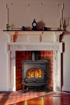 Brick hearth and a jotul f3. My favourite stove