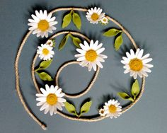 Daisy Felt Flower Garland ~ 100% Wool Felt Die Cut White Daisies on Jute Rope    :: Product Information ::  ~ flowers are made from 100% wool felt, which is soft but very durable ~ The flowers are wired on to 4mm thick jute rope ~ Available in 2 sizes (pictures show small size) ~ Comes boxed for gifts or storage    :: Size Information ::   SMALL ~ Total length 1.5m (4ft11) fits width of a single bed ~ 0.9m of flowers + 0.3m at each end to tie ~ 4 x large daisies 7cm (3) ~ 3 x medium daisy…