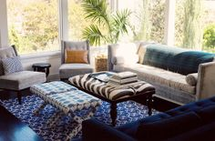 A CUP OF JO: Los Angeles home tour Credits: Seagrass basket for the tree: West Elm. Grey sofa: Jonathan Adler. Blue sofa: Room & Board. Two grey chairs: Jonathan Adler. Leather pillow: CB2. Ikat ottomans: Jonathan Adler. Zebra coffee table: Vintage. Blue rug: John Robshaw.