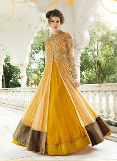 Buy online yellow colored desinger anarkali salwar suit at lowest price. This desinger anarkali salwar suit is prettified with attractive patterns of embroidered, lace and shimmer work. Long Anarkali Gown, Anarkali Suits, Saree Gown, Lehenga Saree, Western Gown, Salwar Kameez Online, Kurti Designs Party Wear, Designer Anarkali, Desi Clothes