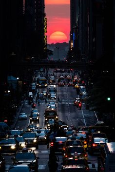 "42nd Street illumination  The sun sets along 42nd Street in Manhattan on May 29 during an annual phenomenon known as ""Manhattanhenge,"" when the sun aligns perfectly with the city's transit grid."