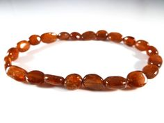 Hessonite Garnet Stretch Bracelet Smooth Round Tumbled Nugget Bead Rust Orange Garnet Gemstones Rare by SandiLaneFineArt on Etsy