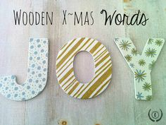 With a pack of wooden letters from the dollar store, you can make festive and unique X~mas decor...like these Wooden X~mas Words