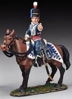 Napoleonic British Army NAP027B Busby Helmet Cavalry Pointing - Made by Thomas Gunn Military Miniatures and Models. Factory made, hand assembled, painted and boxed in a padded decorative box. Excellent gift for the enthusiast.