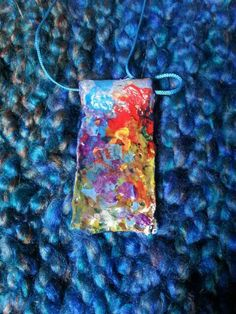 Check out this item in my Etsy shop https://www.etsy.com/uk/listing/275606284/colourful-clay-pendant
