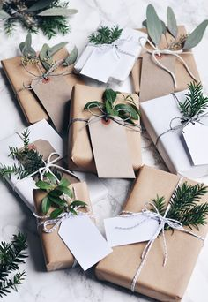 Give gifts a clean, natural look by using twine to secure simple tags and green foliage to the top.