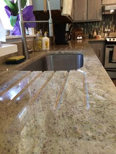 Using an old idea in our new kitchen. Created a drain board in the granite countertop reminiscent of the old porcelain farmhouse sinks.